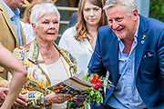 Dame Judi Dench is shown the Welcome to Yorkshire Garde  Designed by, Mark Gregory, Built by Landform Consultants Ltd - Press preview day at The RHS Chelsea Flower Show.