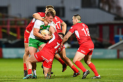 11th November 2018 , Racecourse Ground,  Wrexham, Wales ;  Rugby League World Cup Qualifier,Wales v Ireland ; Declan O'Donnell of Ireland is tackled by Dan Fleming of Wales <br /> <br /> <br /> Credit:   Craig Thomas/Replay Images