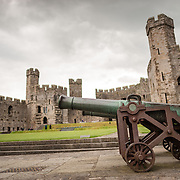 Cannons at Caernarfon Castle in northwest Wales. A castle originally stood on the site dating back to the late 11th century, but in the late 13th century King Edward I commissioned a new structure that stands to this day. It has distinctive towers and is one of the best preserved of the series of castles Edward I commissioned.