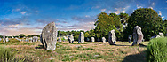 View of Carnac neolthic standing stones monaliths, Alignements du Menec, a pre-Celtic site of standing stomes used from 4500 to 2000 BC,<br /> <br /> Carnac is famous as the site of more than 10,000 Neolithic standing stones, also known as menhirs. The stones were hewn from local rock and erected by the pre-Celtic people of Brittany. The Carnac stones were erected during the Neolithic period which lasted from around 4500 BC until 2000 BC. One interpretation of the site is that successive generations visited the site to erect a stone in honour of their ancestors.