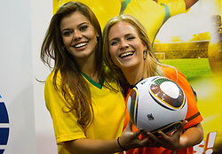 Miss Brazil Luciana Reis  and Miss Netherlands Francis Beukevelb at Miss World contestants from the quarter finals FIFA World Cup 2010 at AIPS glamour event on June 30, 2010 at Nelson Mandela Square in Sandton Convention Centre in Johannesburg. (Photo by Vid Ponikvar / Sportida)