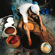 Making naan bread in a clay oven on the street, Lucknow, Uttar Pradesh, India.