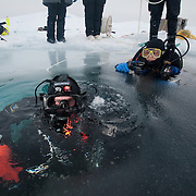 Shawn Harper and Katrin Iken prepares to dive in the ARctic Ocean.
