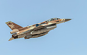 """Israeli Air Force (IAF) General Dynamics F-16D in flight with a blue sky background. Photographed at the """"Blue-Flag"""" 2017, an international aerial training exercise hosted by the Israeli Air Force (IAF) at Ouvda airfield, Israel. November 2017"""