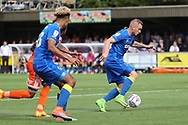 AFC Wimbledon midfielder Dean Parrett (18) dribbling and on the attack during the EFL Sky Bet League 1 match between AFC Wimbledon and Shrewsbury Town at the Cherry Red Records Stadium, Kingston, England on 12 August 2017. Photo by Matthew Redman.