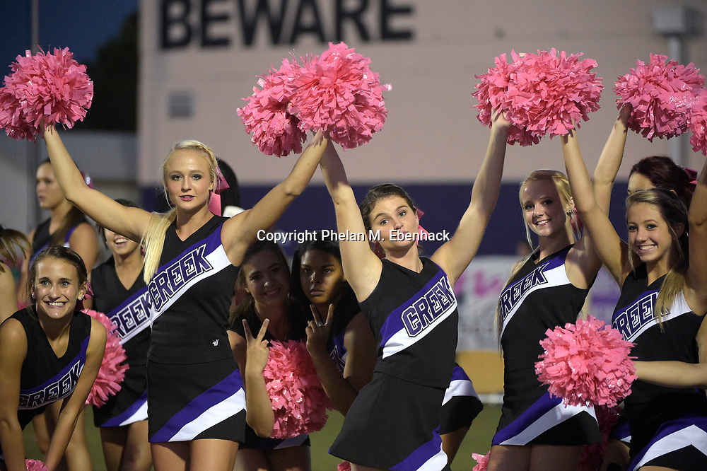 Timber Creek cheerleaders pose for photos before a high school football game against Edgewater in Orlando, Fla., Friday, Oct. 10, 2014. (Photo by Phelan M. Ebenhack)