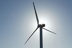 Sun behind turbine at Oldside windfarm; Workington,