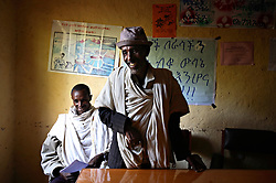 Members of the Adet village Women's Affairs office try to convince a father not to marry off his 8-year-old daughter in Adet Village, Amhara Region, Ethiopia on May 17, 2007.  He agreed to their request.