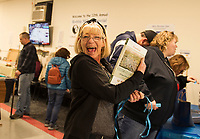 Donah Dearborn picks up her winnings in the silent auction during the 12th annual Robbie Mills Pool Tournament on Saturday at the Laconia Rod and Gun.  (Karen Bobotas/for the Laconia Daily Sun)