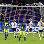 ORLANDO, FL - JANUARY 22:  Megan Rapinoe #15 of United States celebrates with Emily Sonnett #14 and Samantha Mewis #3 after she scores on a penalty kick against Sandra Sepulveda #12 of Columbia while Jorelyn Carabali #16 and Diana Ospina #4 look on at Exploria Stadium on January 22, 2021 in Orlando, Florida. (Photo by Alex Menendez/Getty Images) *** Local Caption *** Megan Rapinoe; Emily Sonnett; Samantha Mewis; Sandra Sepulveda; Diana Ospina; Jorelyn Carabali