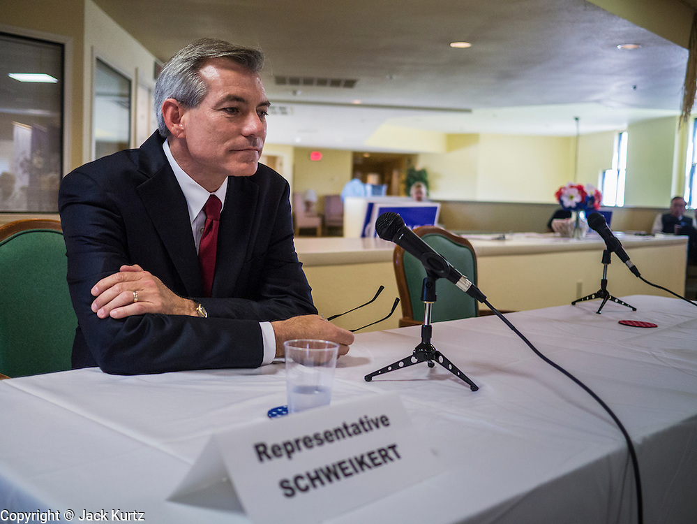 09 AUGUST 2012 - SCOTTSDALE, AZ: Congressman DAVID SCHWEIKERT waits for Congressman Ben Quayle (R-AZ) to arrive before a candidate forum at an assisted living facility in Scottsdale, AZ, Thursday. Republican Congressmen Ben Quayle and David Schweikert are facing each other in Arizona's Aug. 28 Republican primary. They are vying for the right to represent Arizona's 6th Congressional District. Both men are incumbent freshmen Congressmen. They were thrown into the same district during the redistricting process after the 2010 census. Both men are conservatives courting the Tea Party vote.    PHOTO BY JACK KURTZ