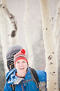 Portrait of backcountry skier Emily Miller in an aspen grove, Uncompahgre National Forest, Colorado.