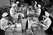 "17/01/1963<br /> 01/17/1963<br /> 17 January 1963<br /> Interiors of Liam Devlin and Sons Ltd. Dublin Sweet Factory at Cork Street, Dublin. Image staff packaging candy sweet-cigarettes, note the boxes of ""cigarette cards"" that were in each packet. Those visible are a series of gun dogs."