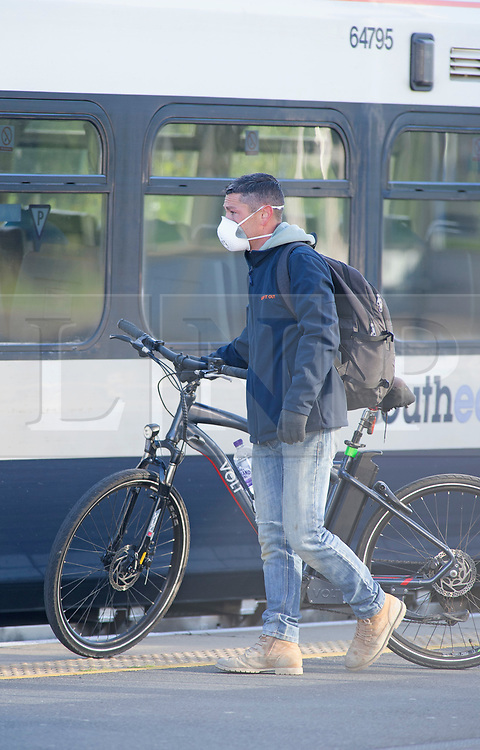 ©Licensed to London News Pictures 14/05/2020<br /> Petts Wood, UK. A builder with his bike about to board a train. Only a handful of London commuters at Petts Wood train station in Petts Wood, South East London this morning due to the on going threat of Coronavirus. Photo credit: Grant Falvey/LNP