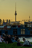 People enjoing the evening sun in Treptower Park, Berlin 2017.