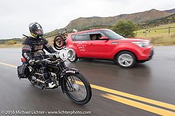 Mechanic and restorer Tanner Whitton of New York riding Mark Hill's 4-cylinder 1915 class-2 Henderson down the west side of Wolf Creek Pass during the Motorcycle Cannonball Race of the Century. Stage-10 ride from Pueblo, CO to Durango, CO. USA. Tuesday September 20, 2016. Photography ©2016 Michael Lichter.