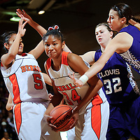 120912  Adron Gardner<br /> <br /> Gallup Bengal Ni'asia McIntosh (34) tucks a rebound from the Clovis Wildcats at the Gallup Invitational in Gallup Saturday.