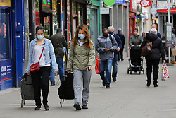 © Licensed to London News Pictures. 21/05/2021. London, UK. Shoppers wearing face coverings in Haringey, north London to protect themselves as cases of the Indian variant in some parts of London have risen by 80% in just one week, according to the latest data from Public Health England. In Haringey, the rate of new cases in the seven days to May 15 has increased by 19%. Photo credit: Dinendra Haria/LNP