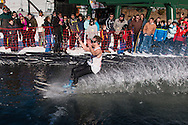 A skier wearing a tank top crosses the water during the Wacky Water Event at the Spring  Rally at Mount Peter Ski and Ride in Warwick, New York. The Spring Rally traditionally closes the season at the ski area.