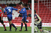 Photo: Lee Earle.<br /> Brentford v Bradford City. Coca Cola League 1. 02/09/2006. Bradford's David Wetherall (L) congratulates Mark Bower after he scored their opening goal.