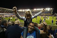 Millwall fans celebrate in the stands during a pitch invasion after full time. Skybet football league one play off semi final 2nd leg match, Millwall v Bradford city at The New Den in London on Friday 20th May 2016.<br /> pic by John Patrick Fletcher, Andrew Orchard sports photography.