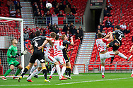Bradford city defender Anthony O'Connor heads the ball high over the bar during the EFL Sky Bet League 1 match between Doncaster Rovers and Bradford City at the Keepmoat Stadium, Doncaster, England on 22 September 2018.