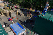 Boy jumps off container in risk averse playground called The Land on Plas Madoc Estate, Ruabon, Wrexham, Wales.