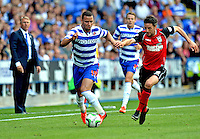 Ipswich Town's Cole Skuse (R) battles with \Reading's Hal Robson-Kanu (C) and Reading's manager Nigel Adkins (L) watches on in the background<br /> <br /> FT: Reading 2 - 1 Ipswich Town<br /> <br />  - (Photo by David Horton/CameraSport) - <br /> <br /> Football - The Football League Sky Bet Championship - Reading v Ipswich Town - Saturday 3rd 2013 - Madejski Stadium - Reading<br /> <br /> © CameraSport - 43 Linden Ave. Countesthorpe. Leicester. England. LE8 5PG - Tel: +44 (0) 116 277 4147 - admin@camerasport.com - www.camerasport.com