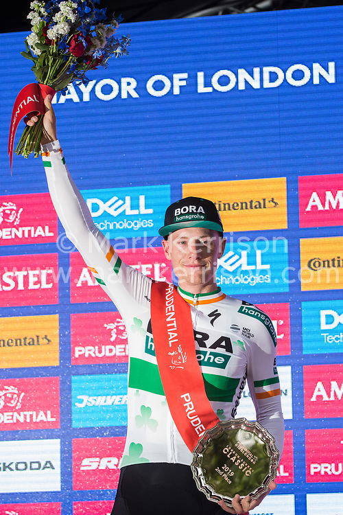 London, UK. 4 August, 2019. Sam Bennett of Bora-Hansgrohe stands on the podium after finishing second in the Prudential RideLondon Classic, Britain's only men's UCI WorldTour race and the richest one-day race in the world with a prize pot of 100,000 Euros on offer. This year's race features a redesigned race route from a start in Bushy Park in south-west London through Surrey, including a five-lap circuit of Box Hill, to a finish on the Mall.