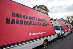 © Licensed to London News Pictures. 17/04/2018. London, UK. Three mobile billboards are driven around Westminster to protest against antisemitism in the Labour Party. Photo credit: Rob Pinney/LNP