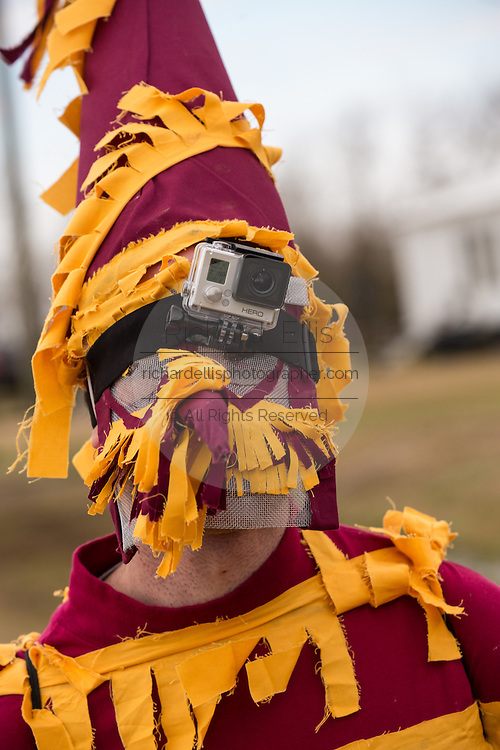 A costumed reveler wears a GoPro video camera on his hat during the Faquetigue Courir de Mardi Gras chicken run on Fat Tuesday February 17, 2015 in Eunice, Louisiana. The traditional Cajun Mardi Gras involves costumed revelers competing to catch a live chicken as they move from house to house throughout the rural community.