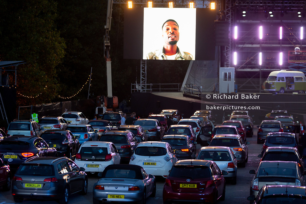 The car park fills up before the technical rehearsal of Puccini's La bohème is performed by members of  English National Opera (ENO) as a drive-in (ENO Drive and Live) at Alexandra Palace, on 18th September 2020, in London, England. This is ENO's first public performance since the closure of their West End Colisseum home venue, because of the Coronavirus pandemic lockdown in March. This is Europe's first live drive-in opera production that audiences can safely experience from their cars and ENO's first public performance since the closure of their West End Colisseum home venue, because of the Coronavirus pandemic lockdown in March. As per the latest government advice. Each bubbled group consists of; 34 members of the<br /> ENO Orchestra, 20 ENO Chorus members and 8 principals. Each bubble has its own individual crew to oversee their rehearsals and performances.