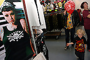 A child is walking through the stands by a poster at the 2nd International Tattoo Convention in London on Saturday, Oct. 7, 2006, in London, UK. With over 15.000 visitors in three days during the 2005 edition, the event placed London in a central position in the tattoo world.  This year about 150 artists ,representing all the tattoo styles, are ticking away with their machines in a very exciting atmosphere. **ITALY OUT**....