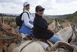 Tourists horseback riding to Temple of the Moon, Cuzco, Peru, South America.  MR