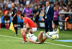 Stuart Dallas of Northern Ireland fouls Gareth Bale of Wales  - Mandatory by-line: Joe Meredith/JMP - 25/06/2016 - FOOTBALL - Parc des Princes - Paris, France - Wales v Northern Ireland - UEFA European Championship Round of 16