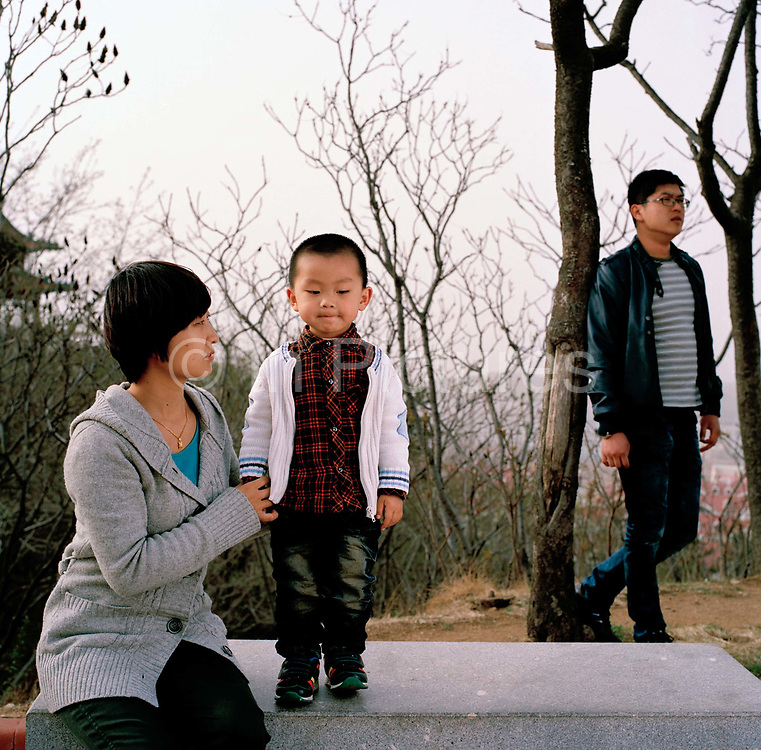 Cai Dong Yan, 30 an insurance broker and her husband Lin Ru, 29 who sells futures for a financial company live in Quixa, Shandong provionce, with their son, Lin Yi Ran who is two. Dong Yan got sterilized last year because she cannot afford to have an accident. It is not compulsory to be sterilized in China after having one child but it is encouraged and the government give a token financial reward to families who get a certificate to prove they have been sterilized. .Its over thirty years (1978) since the Mao's Chinese government brought in the One Child Policy in a bid to control the world's biggest, growing population. It has been successful, in controlling growth, but has led to other problems. E.G. a gender in-balance with a projected 30 million to many boys babies; Labour shortages and a lack of care for the elderly.