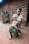 Central African Republic. August 2012. Batalimo. Pk6 - Aka (Biaka) people/ pygmies or 'citizens' as they would rather be known - mother holding malnourished child