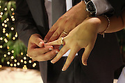 Young married couple with wedding rings