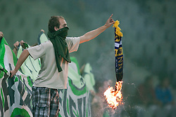 Green Dragons fan with burning scarf of NK Maribor during football match between NK Olimpija and NK Maribor in 5th Round of Prva liga NZS 2012/13, on August 11, 2012 in SRC Stozice, Slovenia. (Photo by Matic Klansek Velej / Sportida.com)