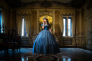 VENICE, FEBRUARY 2018. A model poses at the hystorical Ca' Nigra Palace, wearing a Cinderella costume of the 1800s made with Rubelli silk on February, 2018 in Venice, Italy. Carnival of Venice is also lived inside the palaces, and this selection of costumes, inspired by the Renaissance, keep the classical tradition of the Carnival of Venice, using Rubelli fabrics, silk, gold, silver and precious materials. All the costumes are made by Atelier Pietro Longhi.