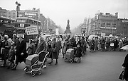 Housewives march in protest at the introduction of Turnover Tax, a new sales tax. The garda wearing white gloves in a raised booth to the centre right of the picture directed traffic on O'Connell Bridge. .14.11.1963.
