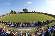 A capacity crowd of 972 at the Robert Eaton Memorial Ground observe a minute of silence the FA Vase 1st Qualifying Round match between Worthing United and East Preston FC at the Robert Eaton Memorial Ground, Worthing, United Kingdom on 6 September 2015. The first home match for Worthing United since losing team mates Matthew Grimstone and Jacob Schilt in the Shoreham air show disaster.