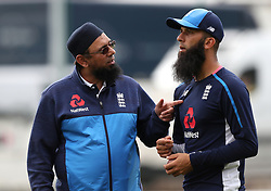 England spin coach Saqlain Mushtaq (left) and Moeen Ali during the nets session at Emirates Old Trafford, Manchester.