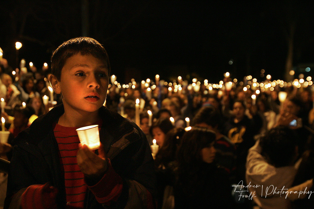 """/Andrew Foulk/ For the North County Times/  .Marcos Gervasio, 9, holds a candle as a sea of around thousand people sing """"Amazing Grace"""" in remembrance of Amber Dubois behind him during a Vigil in her honor at Escondido High School Monday night."""