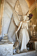 Picture and image of the stone sculpture of an angel on the Raggio Family Tomb 1887. The monumental tombs of the Staglieno Monumental Cemetery, Genoa, Italy .<br /> <br /> Visit our ITALY PHOTO COLLECTION for more   photos of Italy to download or buy as prints https://funkystock.photoshelter.com/gallery-collection/2b-Pictures-Images-of-Italy-Photos-of-Italian-Historic-Landmark-Sites/C0000qxA2zGFjd_k<br /> If you prefer to buy from our ALAMY PHOTO LIBRARY  Collection visit : https://www.alamy.com/portfolio/paul-williams-funkystock/camposanto-di-staglieno-cemetery-genoa.html