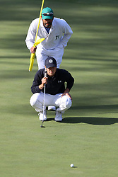April 8, 2018 - Augusta, GA, USA - Jordan Spieth lines up his putt on fifteen where he birdied to go 13 under during the final round of the Masters at Augusta National Golf Club on Sunday, April 8, 2018, in Augusta, Ga. (Credit Image: © Curtis Compton/TNS via ZUMA Wire)