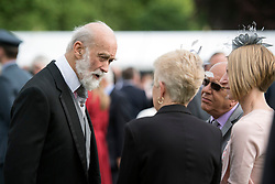 Prince Michael of Kent talks to guests during a garden party at Buckingham Palace in London.