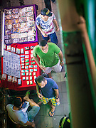 23 AUGUST 2014 - BANGKOK, THAILAND: Tourists walk past a vendor stall selling generic Viagra, Cialis, and porn on a sidewalk market on Sukhumvit Road near Soi 5 in the Nana section of Bangkok. The Thai military junta, formally called the National Council for Peace and Order (NCPO), has ordered street vendors off of the sidewalks in an effort to bring order to Bangkok's chaotic sidewalks. Vendors have complained that the new regulations are hurting them economically but largely complied with the military orders.          PHOTO BY JACK KURTZ