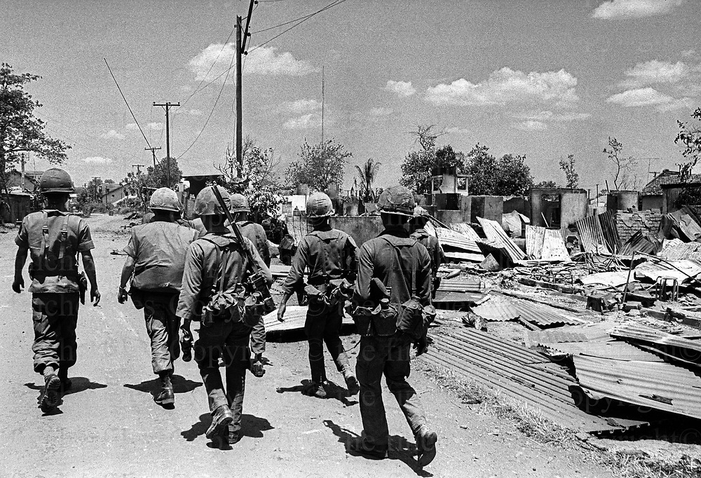 Evacuations near Xuan Loc in South Vietnam as the North Vietnamese army made their advance on the city. South Vietnamese troops move through the ruins of the besieged town of Xuan Loc to take up positions in a vain attempt against the advancing North Vietnamese army - Viet Cong. Vietnam War. Xuan Loc was the last major battle of the Vietnam War fought between 9th and 21st April 1975. Photographed by Terry Fincher.