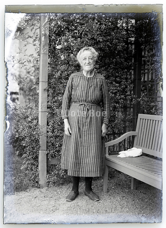 eroding 1900s glass plate with grand mother